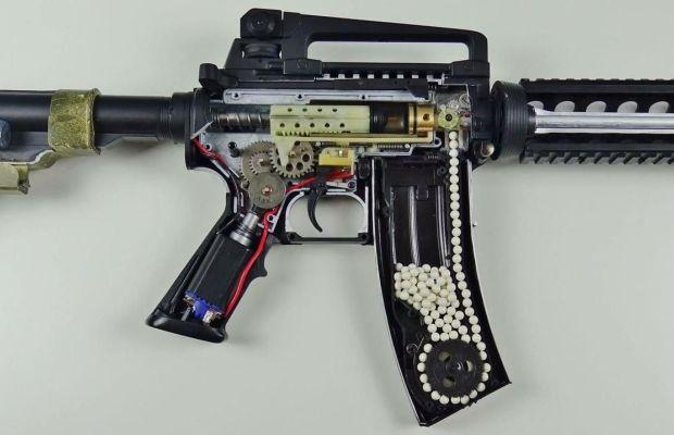 The internals of an electric airsoft gun.